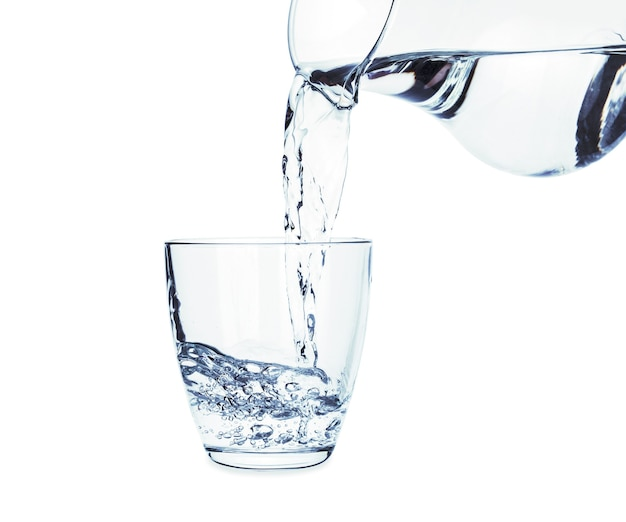 Pouring of fresh water in glass