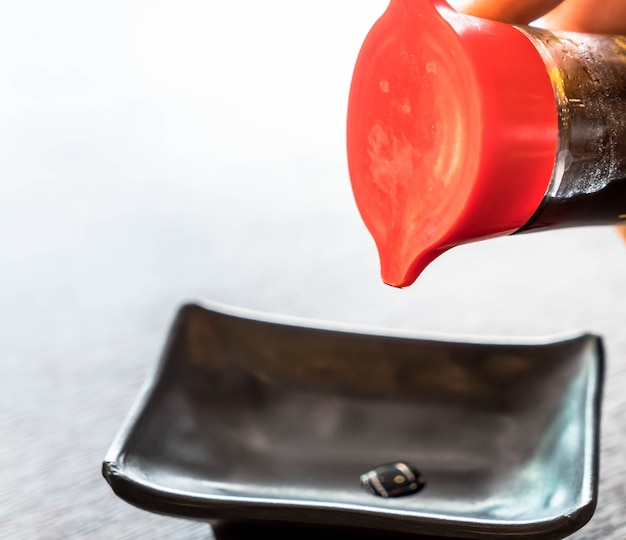 Pouring soy sauce