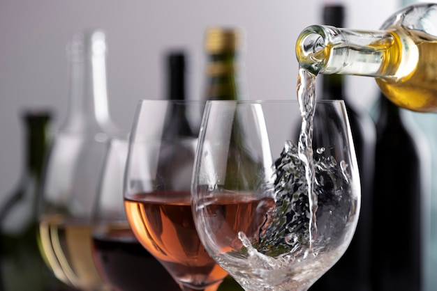 Pouring wine into glasses close-up