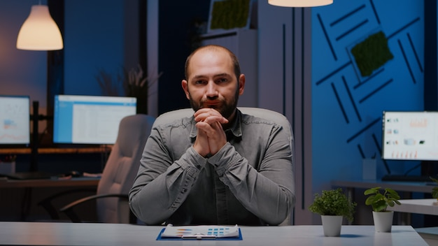 Pov of exhausted businessman discussing with remotely colleague