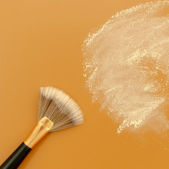 Powder brush on brown background