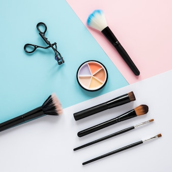 Powder brushes with bright eye shadows on table