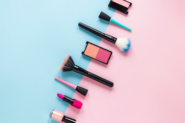 Powder brushes with cosmetics on table