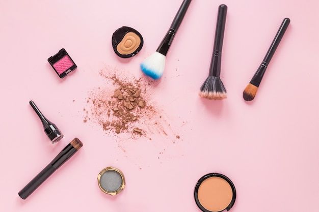 Powder brushes with crushed facial powder on table