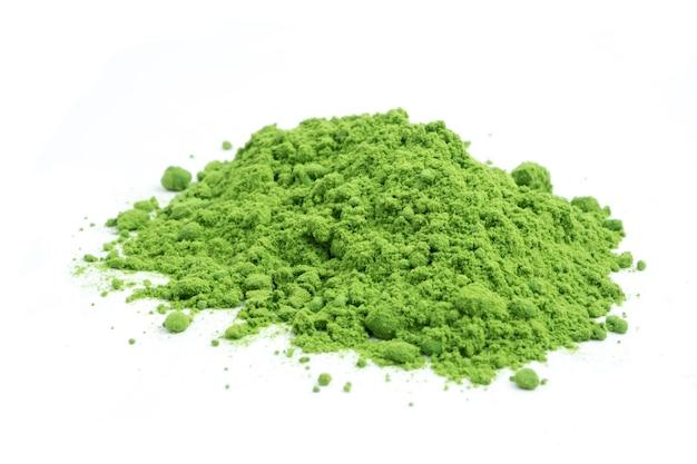 Powdered green tea on white background.