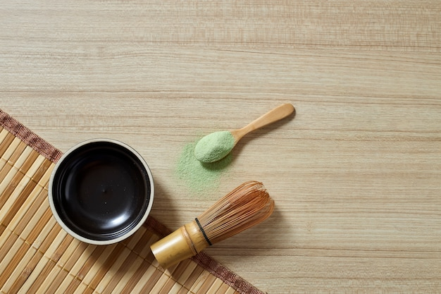 Powdered green tea with bamboo whisk