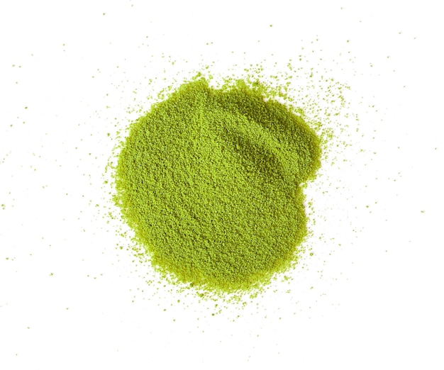 Powdered matcha green tea scattered top view copy space