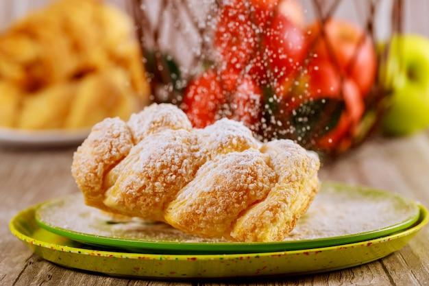 Powdered sugar sprinkle on apple strudel.