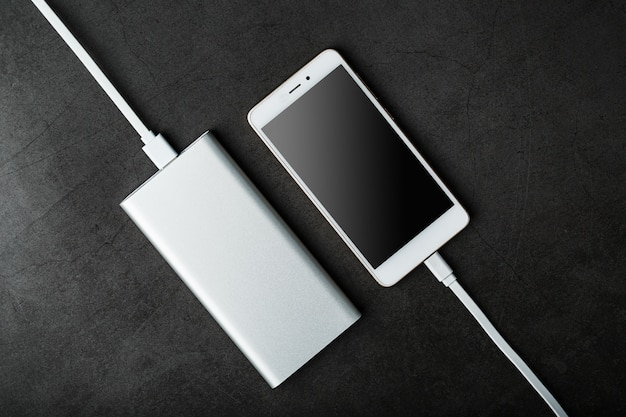 Power bank charges your smartphone. universal external battery for gadgets free space and minimalistic composition.