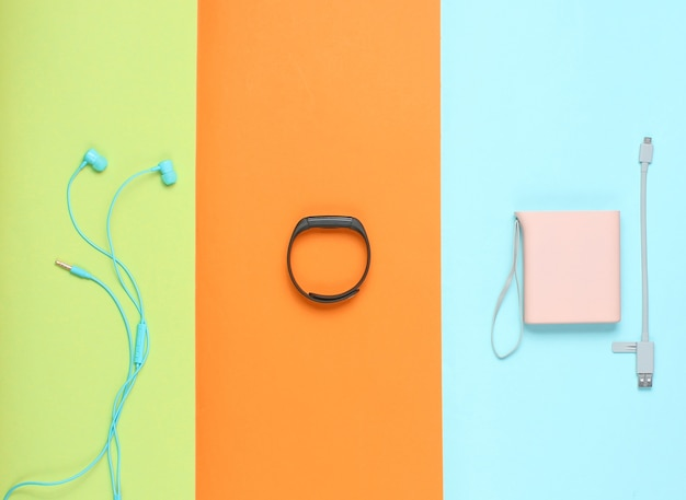 Power bank and usb cable, gamepad, smart bracelet, earphones isolated
