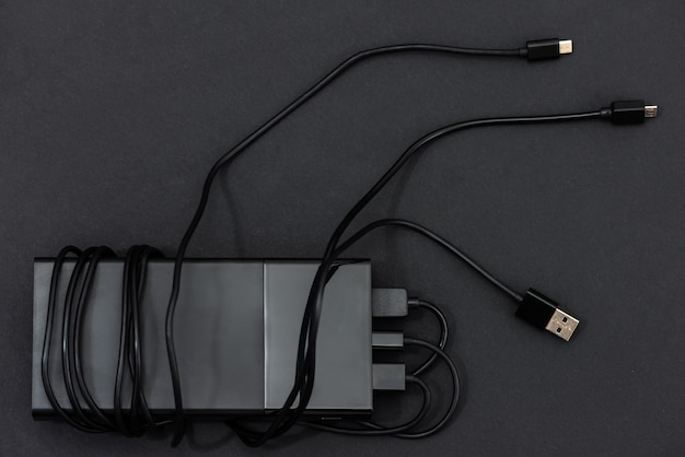 Power bank with charging cables.