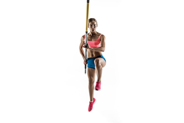 Power and beauty and purity. professional female pole vaulter training on white studio