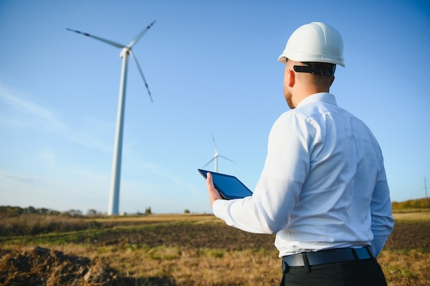 Power engineer are working with wind turbines.