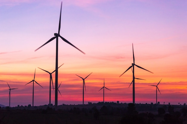 Power generating wind turbines at sunset