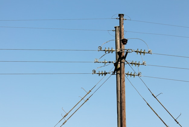 Power line supports against a blue sky background