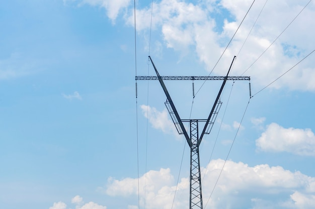 Power lines on the background of the blue sky.