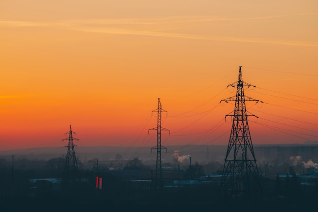 Power lines in city on dawn.