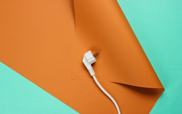 Power plug with cable on wrapped paper