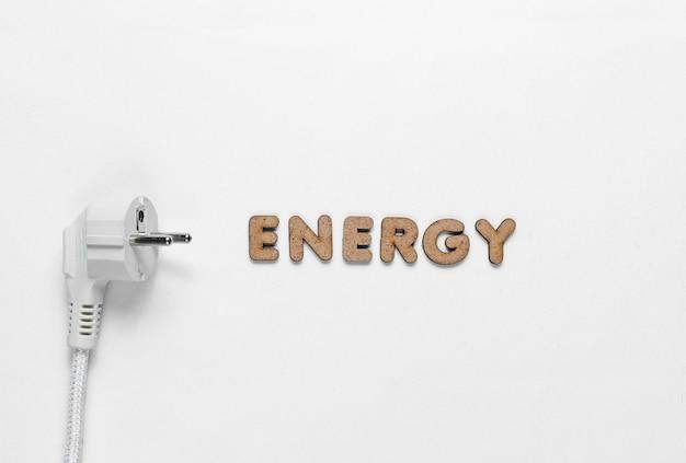 화이트에 단어 에너지와 전원 플러그 프리미엄 사진