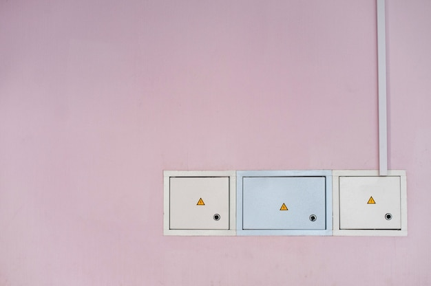 Power supply boxes in the pink wall.