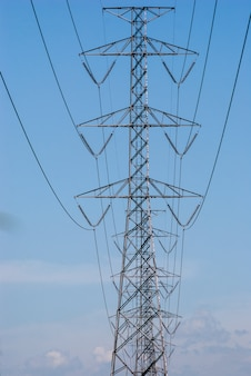Power tower on blue sky background