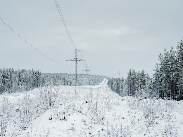 Power towers in the snow-capped northern mountains. russia.