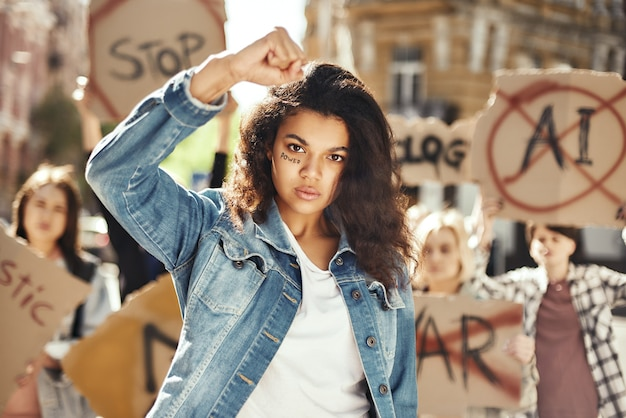 The power of a woman young and strong woman is protesting for women empowerment with