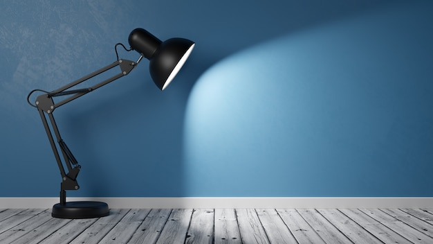 Powered on black desk lamp on wooden floor in the room