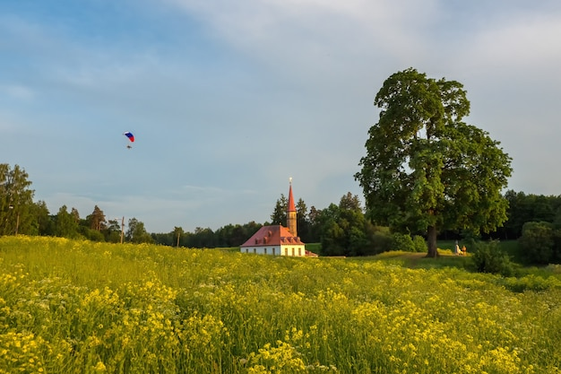 Powered parachute in the evening against the blue sky