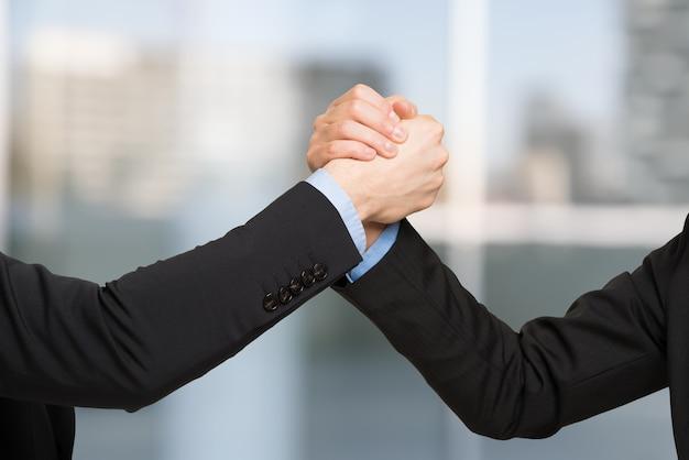 Powerful handshake between business people