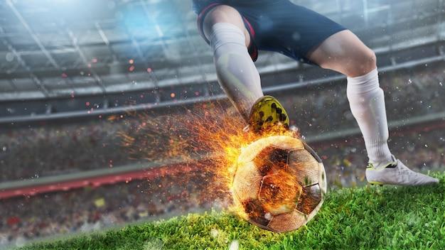 燃えるようなボールを持つサッカー選手の強力なキック