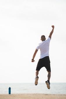 Powerful man celebrating his winning