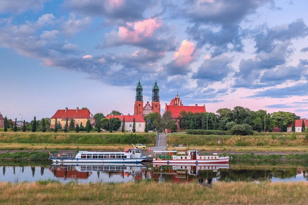 Poznan cathedral on ostrow tumski and warta river at sunset, poznan, poland
