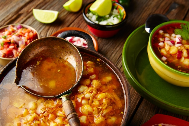 Pozole with mote big corn stew from mexico in  cooking pot