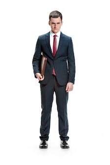 Pportrait of businessman with folder on white wall