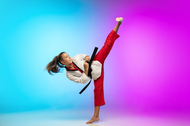Practice. karate, taekwondo girl with black belt