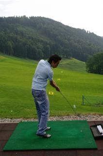 Practicing golf, human
