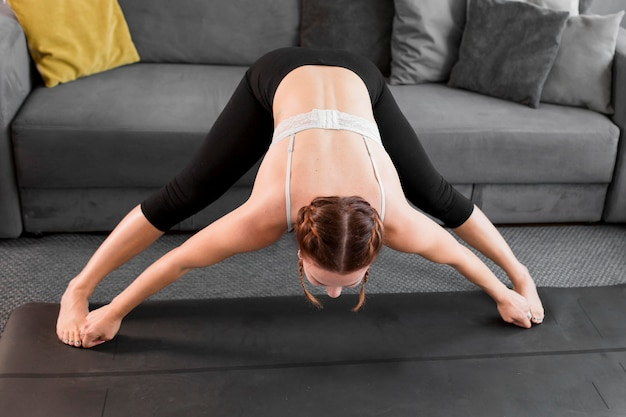Practicing yoga at home concept