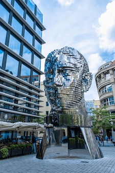 Prague/czech - 05.21.2019: moving monument head franz kafka in the center of prague. art object chromed shiny sculpture of 64 plates