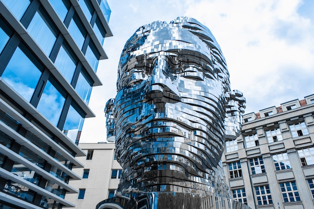 Prague/czech - 05.21.2019: moving monument head franz kafka in the center of prague. art object chromed shiny sculpture of 64 plates.