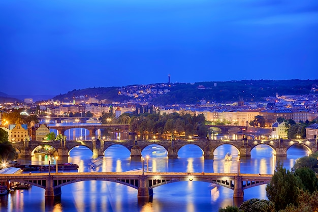 Prague at twilight blue hour, view of bridges on vltava