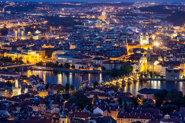 Prague at twilight blue hour, view of charles bridge on vltava with mala strana and old town