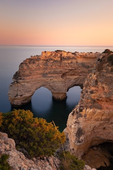 Praia da marinha cove with the famous heart formation of the natural archs at algarve, portugal