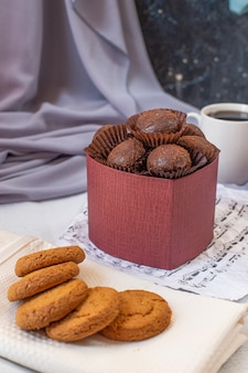 Pralines and oatmeal cookies on the white towel.