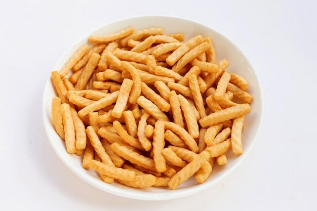 Prawn cracker sticks on white background. shrimp crisp rice snack
