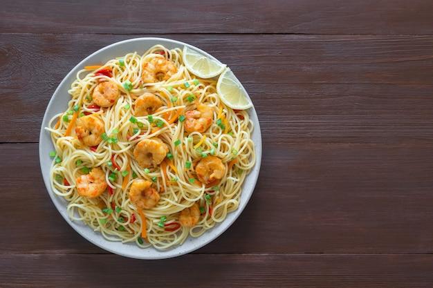 Prawn schezwan noodles with vegetables. top view.