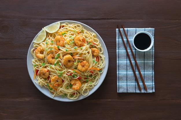 Prawn schezwan noodles with vegetables.