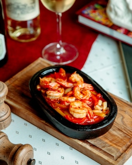 Prawn with vegetables cooked in cast iron pan