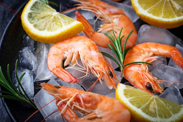 Prawns shrimps with lemon and rosemary. selective focus