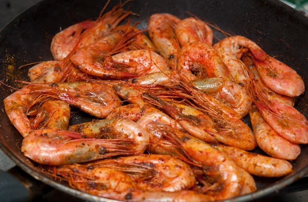 Prawns with spices are fried in a pan